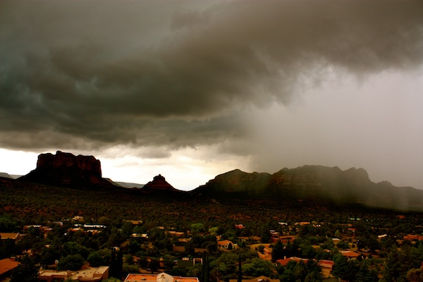 Sedona red rocks under incoming storm clouds and rain in Arizona, USA