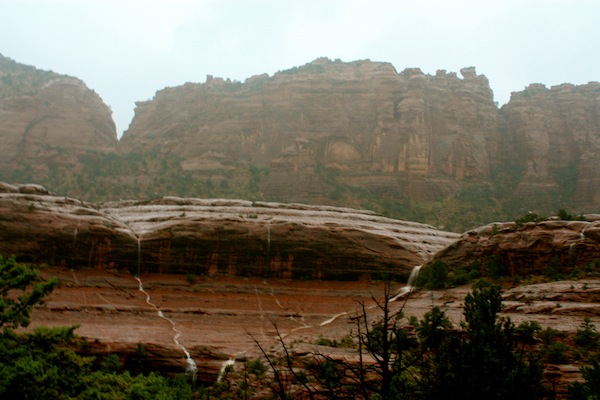 Waterfalls on Sedona red rocks during a thunderstorm in Arizona, USA