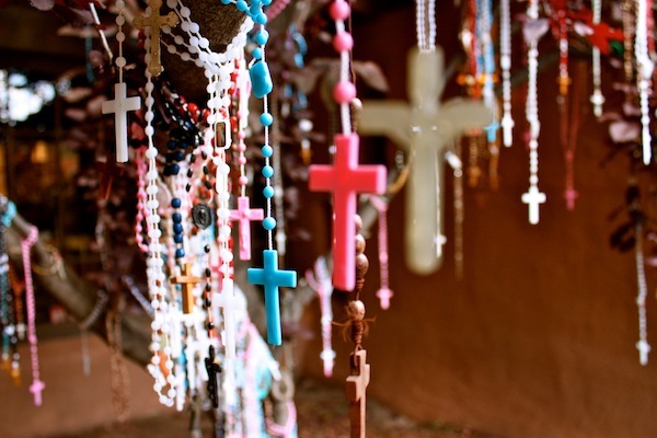 Crosses hanging outside Loretto Chapel in Santa Fe, New Mexico, USA