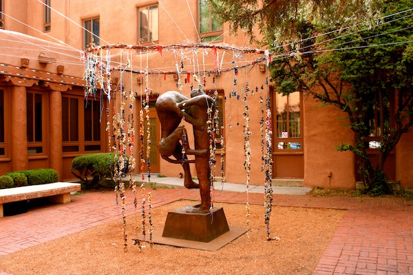 Statue in museum courtyard in Santa Fe, New Mexico, USA