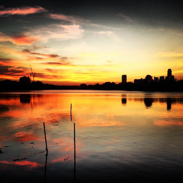 Sunset over the Colorado River and Austin skyline in Texas