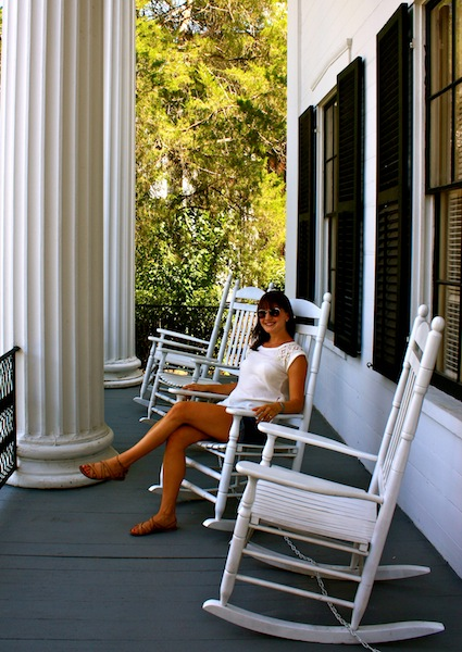 Sitting on the porch of Cannonball House in Macon, Georgia