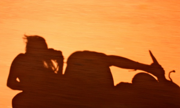 Motorbike shadows on the road on Phu Quoc Island, Vietnam