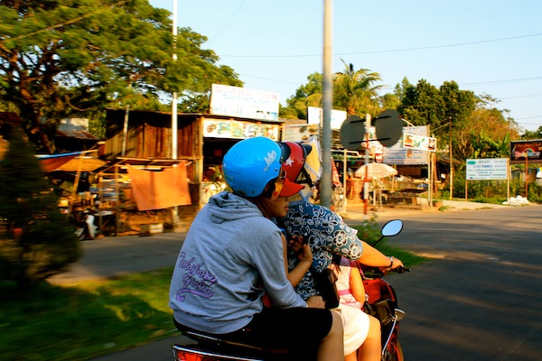 Entire family on a motorbike on Phu Quoc Island, Vietnam