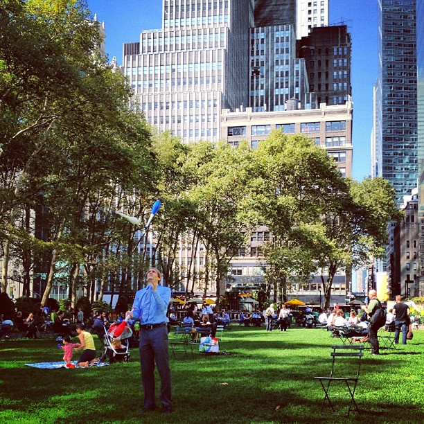 Man juggling in Bryant Park in New York City, USA