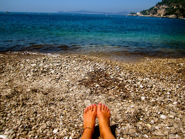 Bare feet at Cap D'Ail Beach in the French Riviera, France