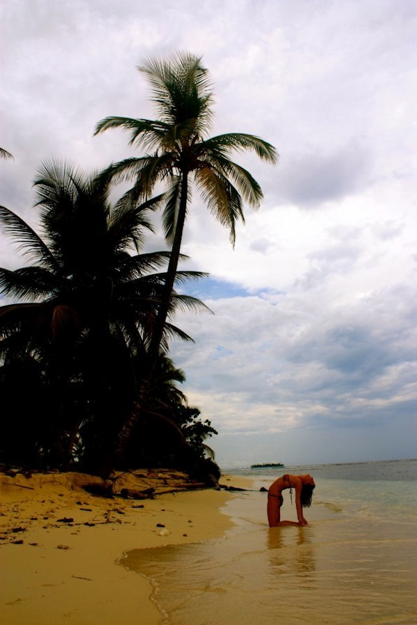 Christine Amorose in camel pose on the San Blas islands