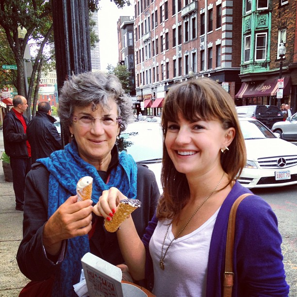 Christine Amorose and her Christine Amorose and her mother eating cannolis in North End, Boston