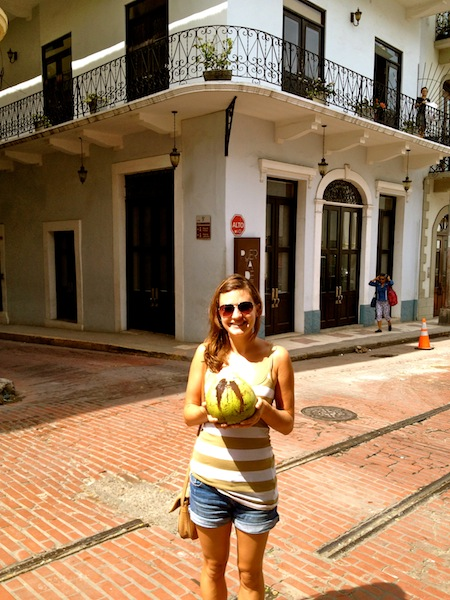 Christine Amorose drinking a coconut in Panama City, Panama