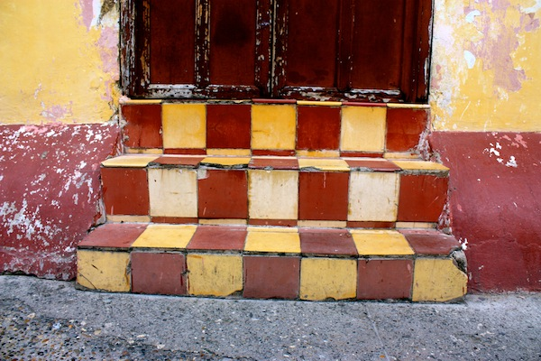 Maroon and yellow tile staircase in Cartagena, Colombia, South America