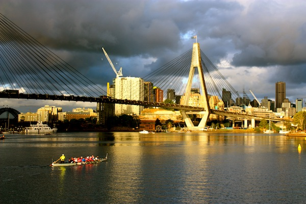 Anzac Bridge and kayakers in Sydney, Australia from Glebe Point