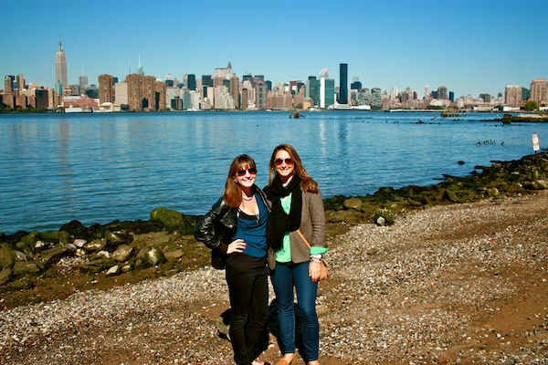 Christine Amorose and Kate Brennan in front of the Manhattan skyline, New York City