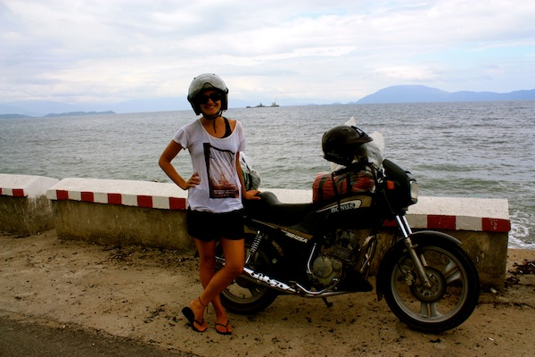 Christine Amorose on a motorbike along the Vietnam coast
