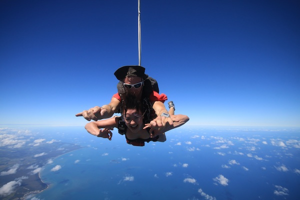 Christine Amorose skydiving over the Great Barrier Reef in Australia