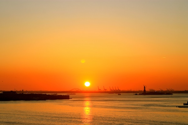 Sunset over the Statue of Liberty from the Brooklyn Bridge