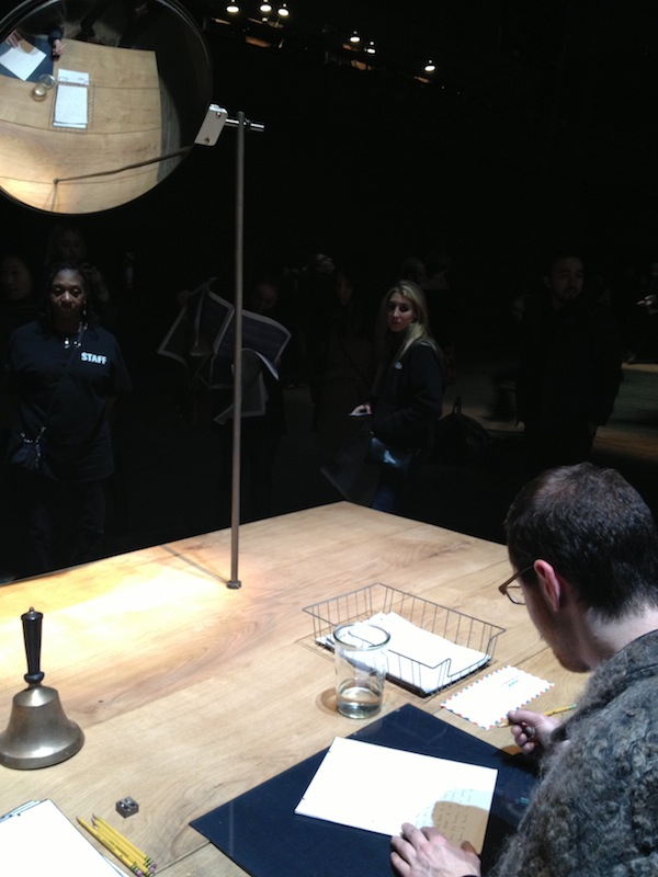 Man writing letters at Event of a Thread by Ann Hamilton at Park Avenue Armory