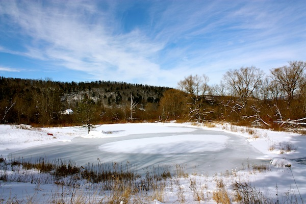 Frozen pond and blue skies in the Berkshires, New York