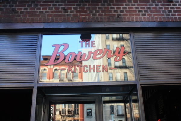 The Bowery Kitchen reflection in the Bowery neighborhood, New York City
