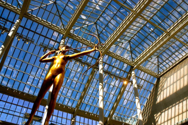 Gold statue and glass ceiling in the Metropolitan Museum of Art in New York City