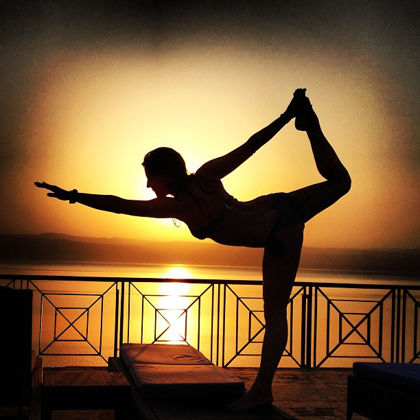 Yoga pose silhouette in a Dead Sea sunset