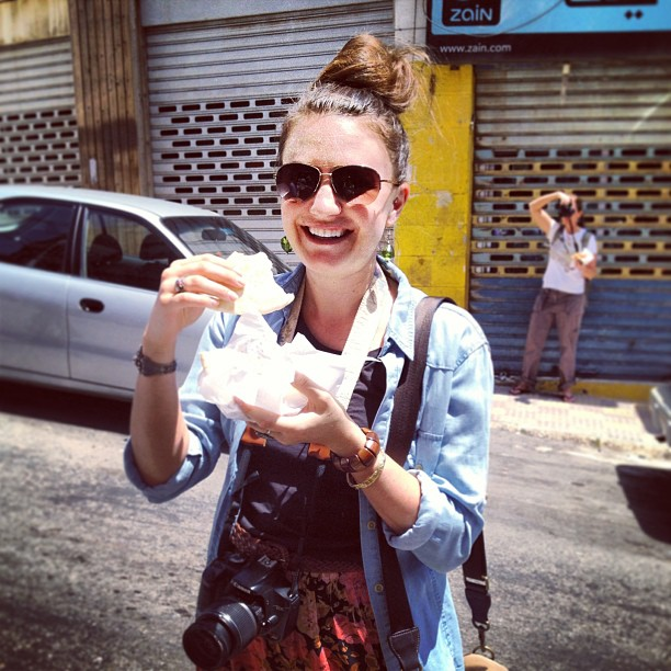Christine Amorose eating a falafel in Amman, Jordan