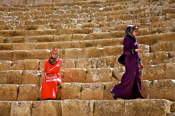 Women in brightly colored burkas in Jordan