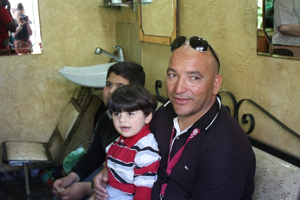 Our guide Ibrahim with local children in Amman, Jordan