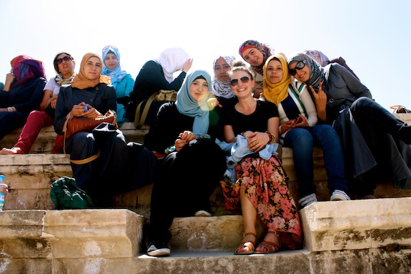 Christine Amorose with young students in Amman, Jordan