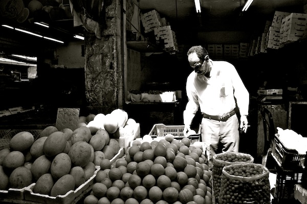 Man selling fruit at market in Amman, Jordan