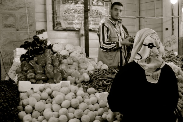 Woman buying fruit at market in Amman, Jordan