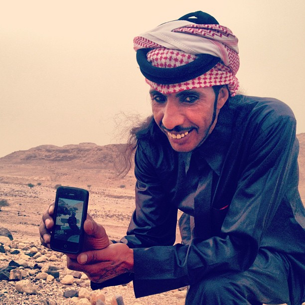 Beduoin with an iPhone in the desert in Jordan