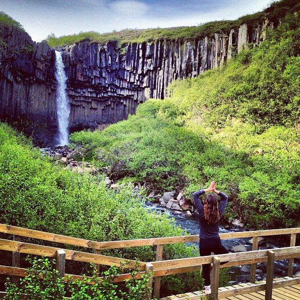 Christine Amorose in tree pose at Svartifoss, Iceland