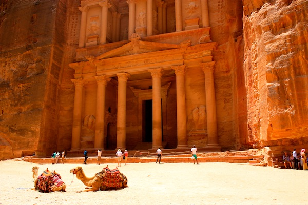Camels and the treasury in the ancient city of Petra in Jordan
