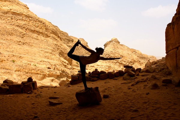 Standing bow yoga pose  in the ancient city of Petra in Jordan