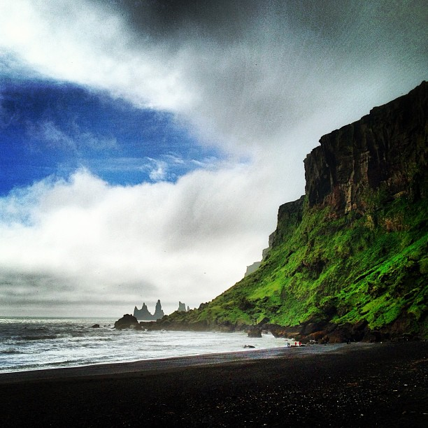 Blue skies over black sand beaches in Vik, Iceland