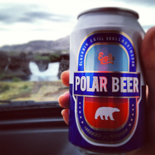Drinking a beer in front of a waterfall in Iceland