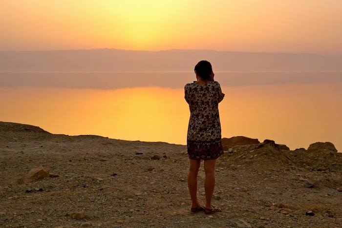 Christine Amorose taking a photo of Dead Sea sunset