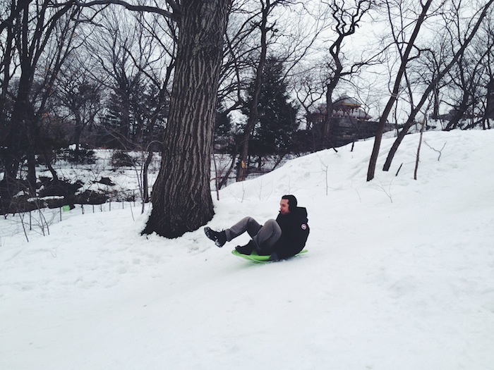 Sledding in Central Park in New York City in the snow