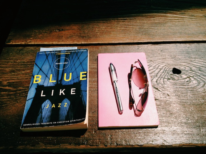 Blue Like Jazz and Moleskine notebook in sunshine