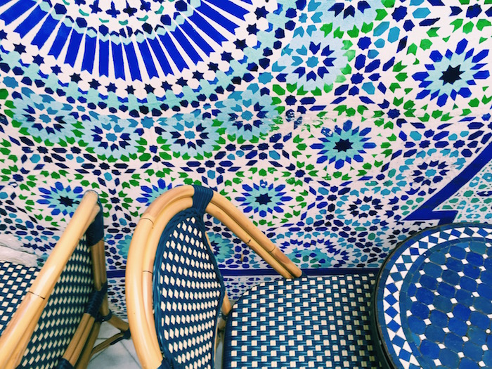 Blue tiles and chairs at Grand Mosque in Paris, France