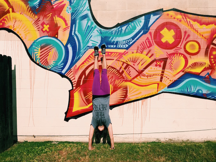 Handstand in front of street art in Midtown Sacramento