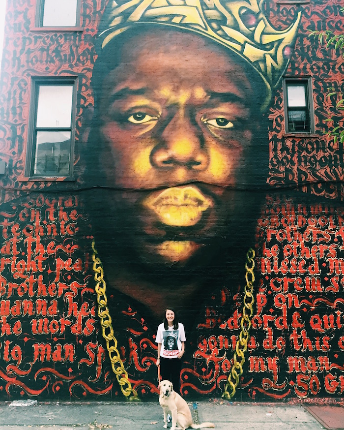 Christine Amorose in front of Notorious Biggie mural in Bed-Stuy