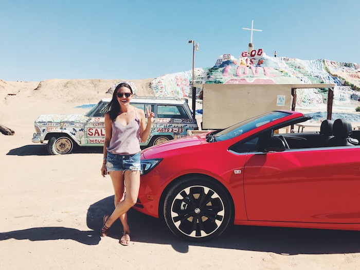 Christine Amorose & Buick Cascada at Salvation Mountain in the California desert
