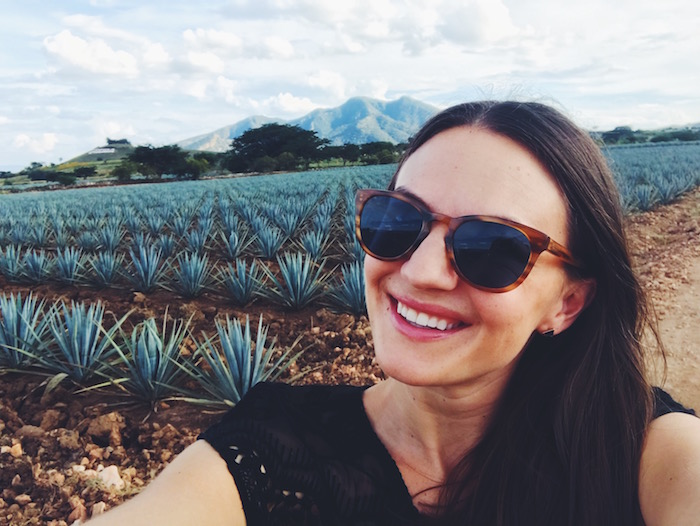 Christine Merrill in fields of blue agave in Tequila