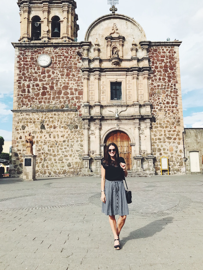 Christine Merrill in front of church in Tequila, Jalisco
